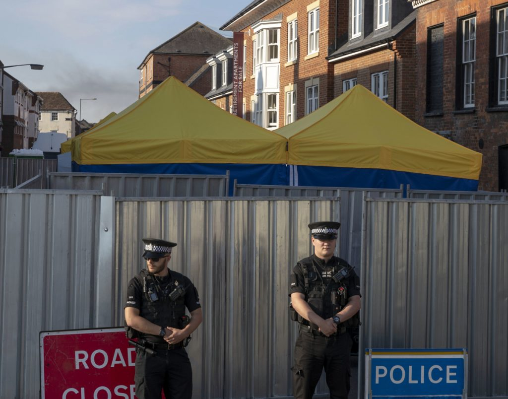 Police secure a point of interest in Salisbury, where counter-terrorism officers were investigating Monday after a woman and her partner were exposed to a nerve agent.