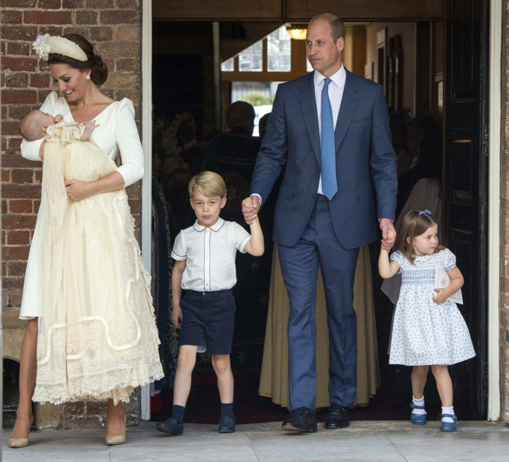 Britain's Prince William and Kate, Duchess of Cambridge, with their children Prince George, Princess Charlotte and Prince Louis arrive for Prince Louis' christening service at the Chapel Royal, St James's Palace, in London on Monday.