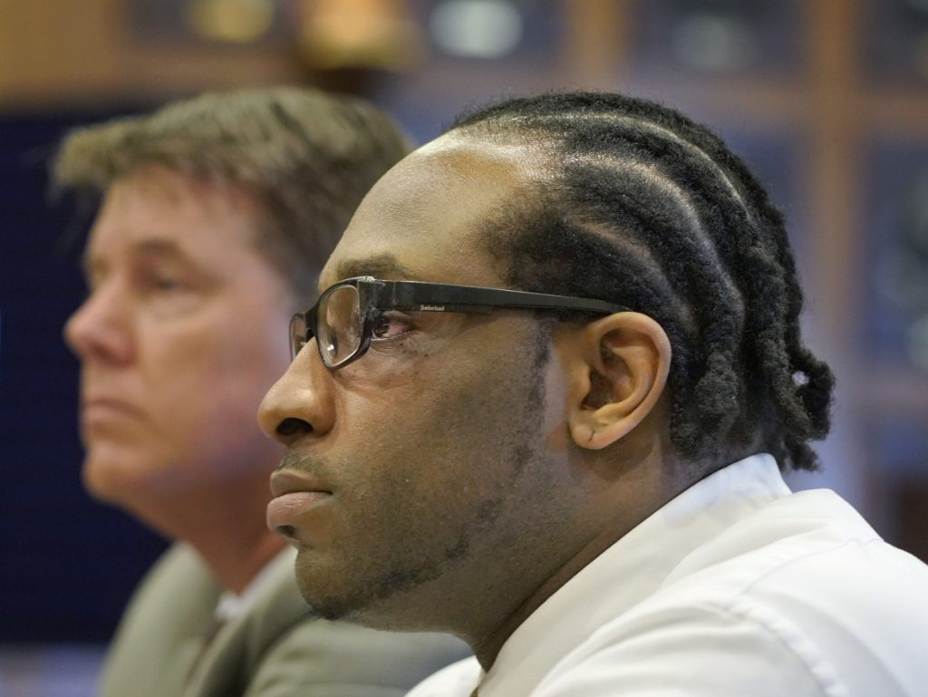 David W. Marble Jr. and his attorney Jon Gale listen as Assistant Attorney General Meg Elam makes her opening statement at the Cumberland County Courthouse in Portland on Tuesday, July 10, 2018. Marble is on trial for two murder charges stemming from the Dec. 25, 2015 shooting deaths of Eric Williams and Bonnie Royer in Manchester.