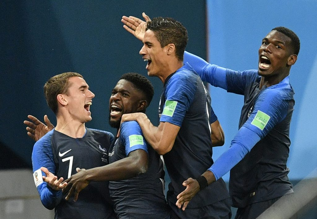 Samuel Umtiti, second from left, is congratulated by teammates Antoine Griezmann, Raphael Varane and Paul Pogba, from left, after scoring a goal Tuesday in France's 1-0 semifinal victory over  Belgium at the World Cup in the St. Petersburg Stadium in Russia. (AP Photo/Martin Meissner)