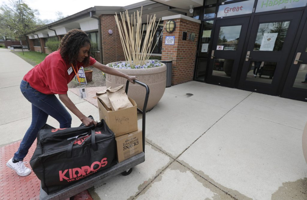 Nichele Gilling of Kiddos Catering in Chicago delivers prepared lunches to Kipling Elementary School in Deerfield, Ill. Many parents still make their kids' lunch or sign up for a hot-lunch program, but others order from companies that deliver meals to homes or schools.