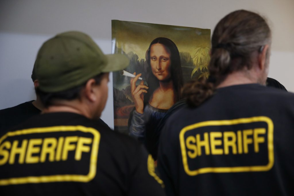 Los Angeles County sheriff's deputies raid an illegal marijuana dispensary earlier this year. As retail marijuana operations increase rapidly, so-called experts are promising health benefits that have yet to be proven.