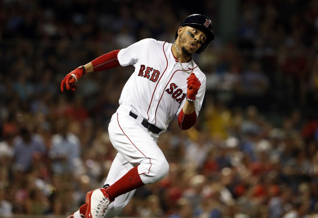 Boston's Mookie Betts runs out a double against the Texas Rangers in the fifth inning Tuesday night in Boston.