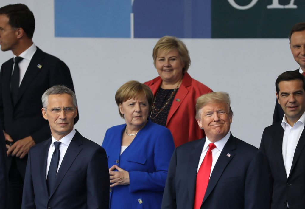 President Trump, German Chancellor Angela Merkel, center, and NATO Secretary General Jens Stoltenberg, left, stand for a photo during the NATO summit in Brussels on Wednesday.