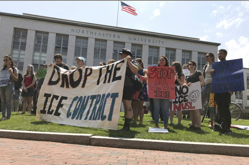 Students and community activists rally at Northeastern University on  Wednesday demanding the school cancel a multimillion-dollar research contract with U.S. Immigration and Customs Enforcement.