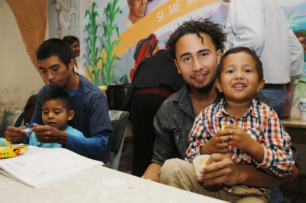 Roger Ardino, 24, and his son Roger Ardino Jr., 4, and Pablo Ortiz, 28, left, and his son Andres, 3, speak to the media in El Paso, Texas, on Wednesday. Ardino and Ortiz were reunited with their sons Tuesday night after months of separation.