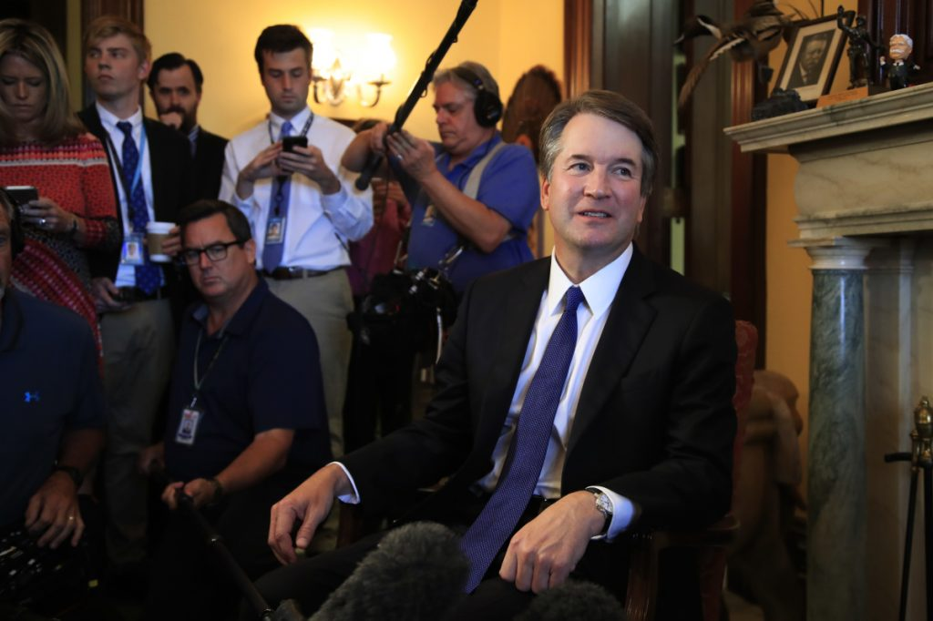 Supreme Court nominee Brett Kavanaugh listens to Sen. Rob Portman, R-Ohio, on Capitol Hill during a meeting Wednesday.