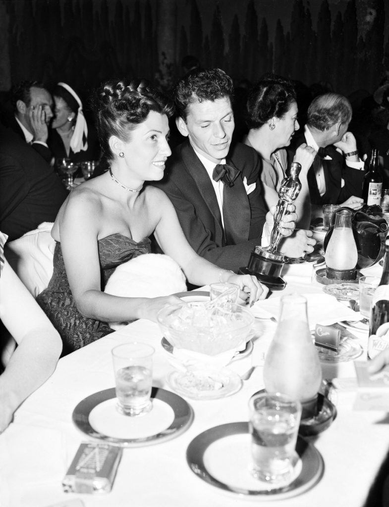 "At a crowded table at Ciro's in March of 1946, Frank Sinatra steals a glance at the Oscar he won for his performance in the film ""The House I Live In,"" as his wife Nancy looks on. Nancy Sinatra Sr., the childhood sweetheart of Frank Sinatra who became the first of his four wives and the mother of his three children, has died. She was 101. Her daughter, Nancy Sinatra Jr., tweeted that her mother died Friday, July 13, 2018.  ()"