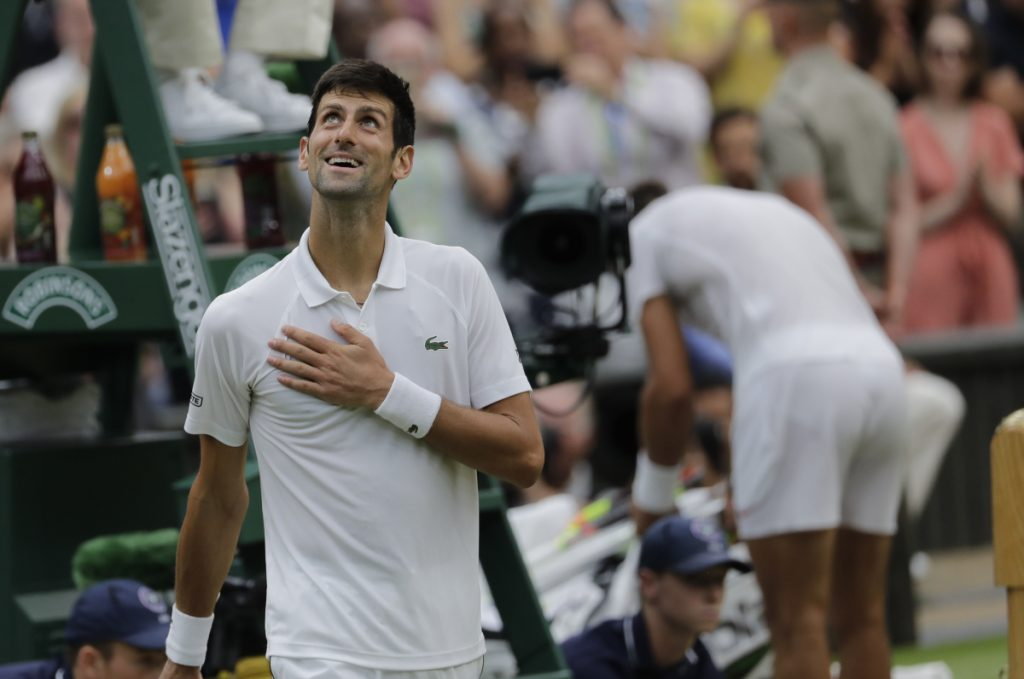 Serbia's Novak Djokovic smiles after defeating Rafael Nadal of Spain during their semifinals match at Wimbledon in London on Saturday.
