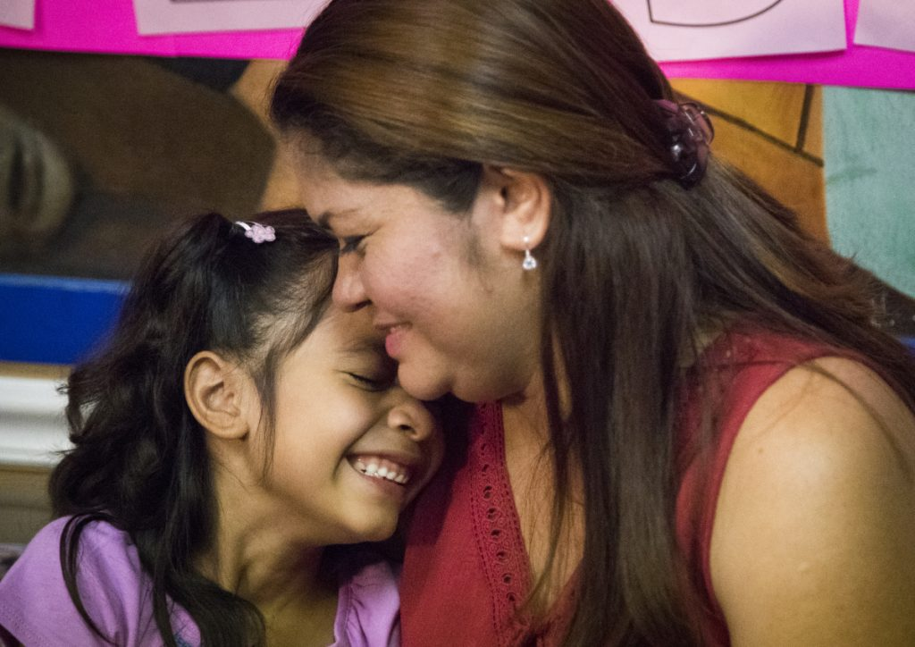 Alison Madrid, 6, and her mother, Cindy, who were separated at the U.S.-Mexico border in June, embrace after being reunited Friday in Houston.