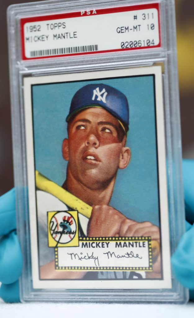 "The ""Holy Grail"" of baseball cards, a 1952 Topps Mickey Mantle, is valued at millions of dollars. One of the three with a gem mint rating will be on display in Denver."