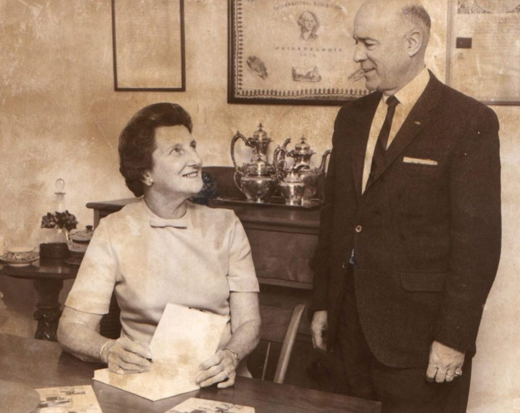 "Lowell N. Weston of East Winthrop chats with Marjorie Standish while she signs copies of ""Cooking Down East"" – one each for Weston's wife, mother-in-law and brother-in-law – in this photo from January 1969."