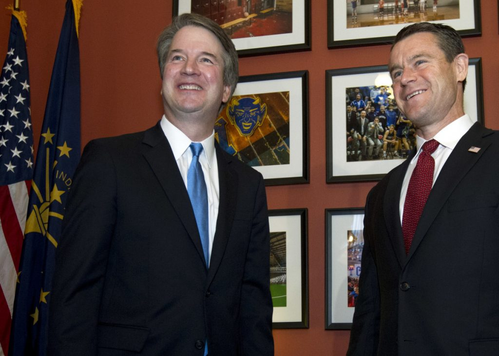 Supreme Court nominee Judge Brett Kavanaugh, left, meets with Sen. Todd Young, R-Ind., on Tuesday.