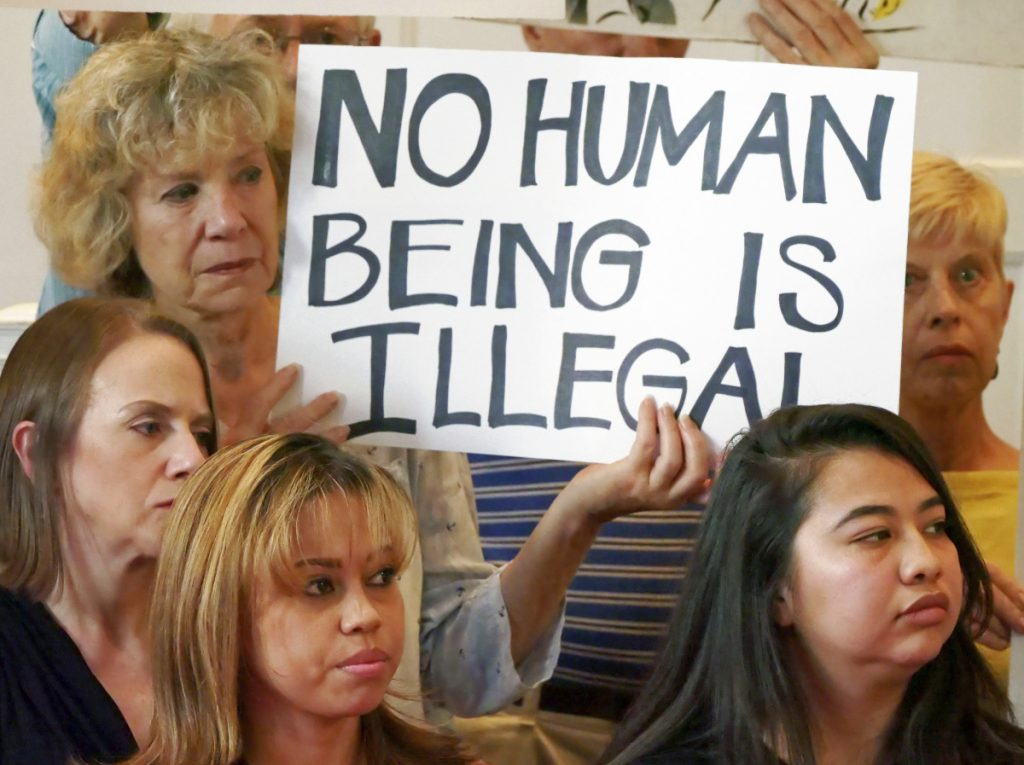 """Sanctuary city"" supporters in Salt Lake City, at left, protest the government's immigration policies. New York state and city, Connecticut, New Jersey, Washington, Massachusetts and Virginia have filed lawsuits arguing that the government is unlawfully forcing sanctuary cities to cooperate with federal immigration enforcement."