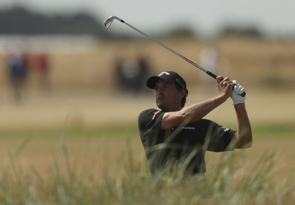 Kevin Kisner plays out of the rough on the 18th hole during the first round of the British Open golf championship in Carnoustie, Scotland, on Thursday. (AP Photo/Jon Super)