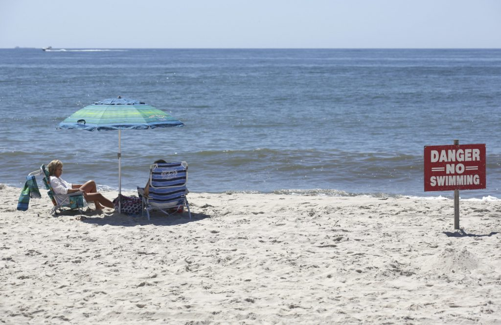 "A ""no swimming"" sign is seen near Ocean Beach on Fire Island in Islip, N.Y. on Thursday."