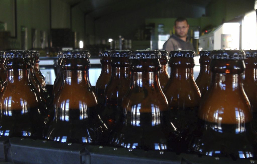 Freshly bottles of beer stand in the Darling Brewery in Darling, South Africa. The South African brewery appears to be the first in Africa to go carbon-neutral as more businesses across the continent adjust to climate change, and as consumers become more careful about the products they buy.