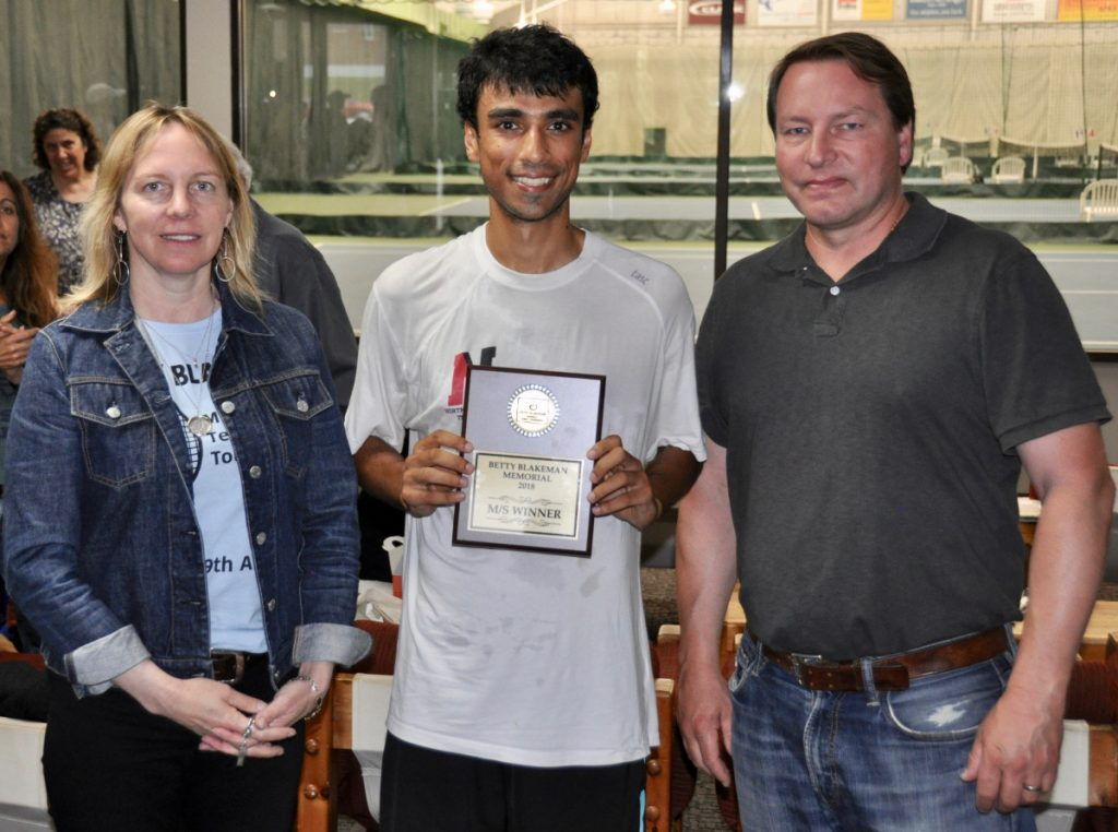Unseeded Jai Aslam, pictured with tournament organizer Carrie Davenport, left, and Eric Blakeman, right, won the Betty Blakeman Memorial Tournament on Sunday.