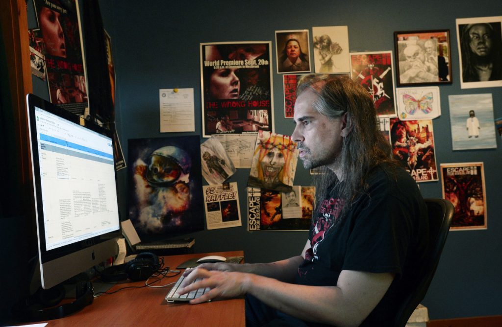 Shawn French, video game writer, comic book writer and movie maker, works on a video game at his Limerick home.