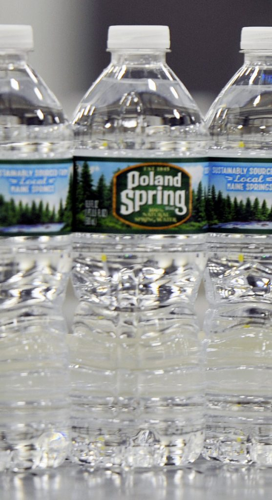HOLLIS, ME - JUNE 21: Bottles of Poland Spring water on a conveyer belt in the Hollis facility Tuesday, June 21, 2016. (Photo by Shawn Patrick Ouellette/Staff Photographer)