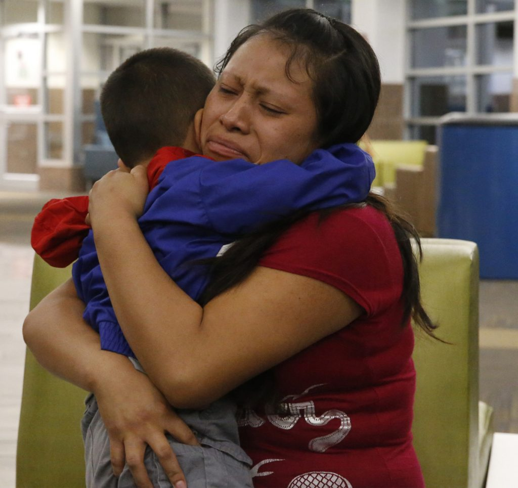 """A mother and son separated for six weeks reunite at a Texas airport Thursday. A judge cites """"persistent problems"""" at places where kids are held."""
