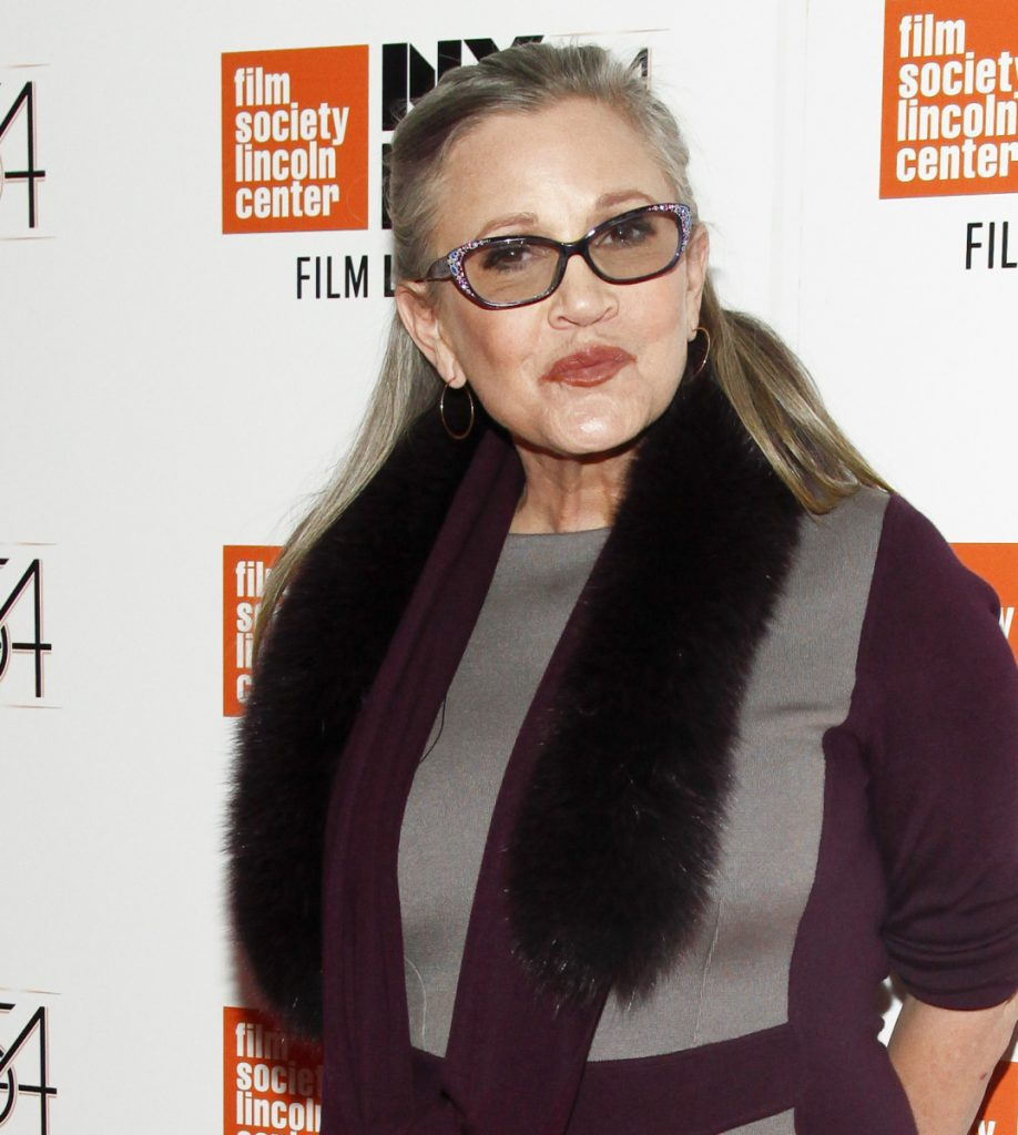 "Director J.J. Abrams says he will use unreleased footage of Carrie Fisher in the next ""Star Wars"" film to give the latest trilogy a ""satisfying conclusion."""