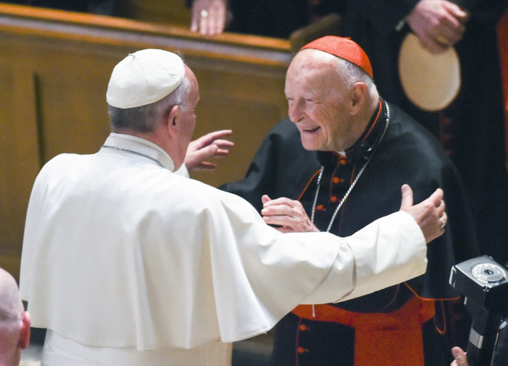 Pope Francis embraces Cardinal Theodore McCarrick at the Cathedral of St. Matthew the Apostle in Washington in 2015. The pope has accepted McCarrick's offer to resign from the College of Cardinals following allegations of sexual abuse, including one involving an 11-year-old boy, the Vatican said Saturday.