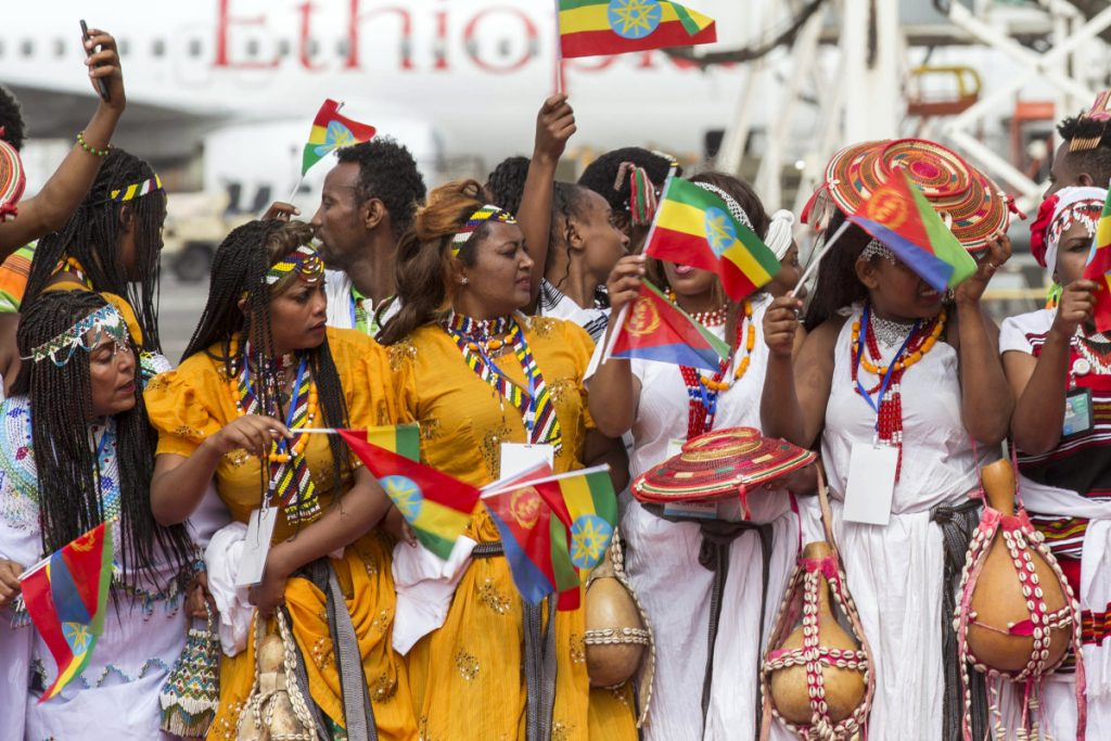 Ethiopian women gather at Addis Ababa International Airport this month to welcome Eritrean President Isaias Afwerki for an unprecedented visit.
