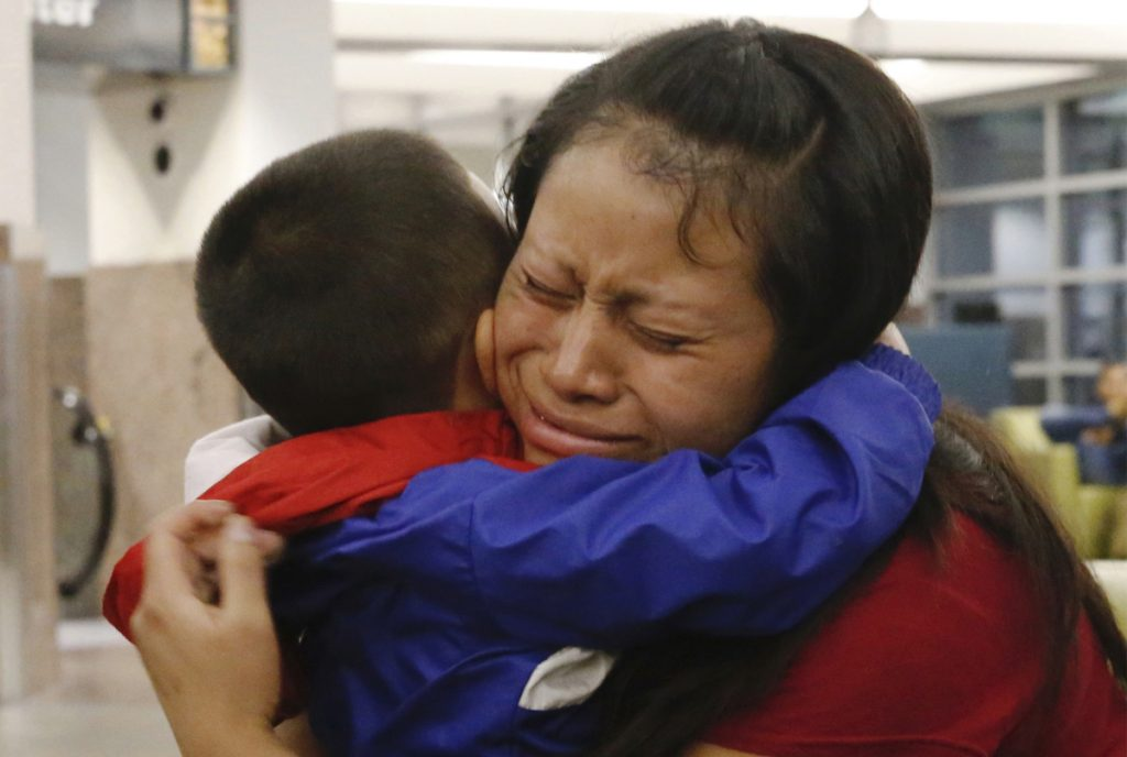 Maria holds her 4-year-old son Franco after he arrived at the El Paso International Airport on July 26. The two had been separated for over six weeks.