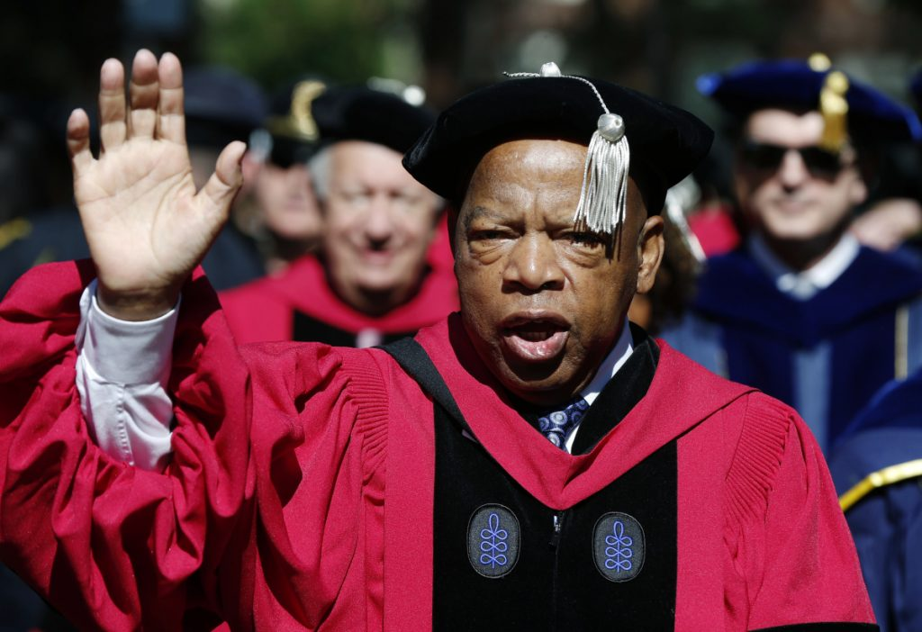 "Rep. John Lewis walks in a procession during Harvard University commencement exercises in Cambridge, Mass. The civil rights icon has been hospitalized for undisclosed reasons Saturday. Citing a statement from Lewis' office, WSB-TV reports that the 78-year-old Georgia congressman was ""resting comfortably"" in a hospital for ""routine observation."" The statement says Lewis expects to be released Sunday."
