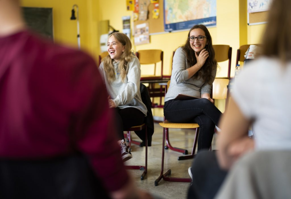 Laura Schulmann, center left, and Sophie Steiert field questions from students about Jewish daily life at a high school in Luckau, Germany. They want to change perceptions and challenge stereotypes.