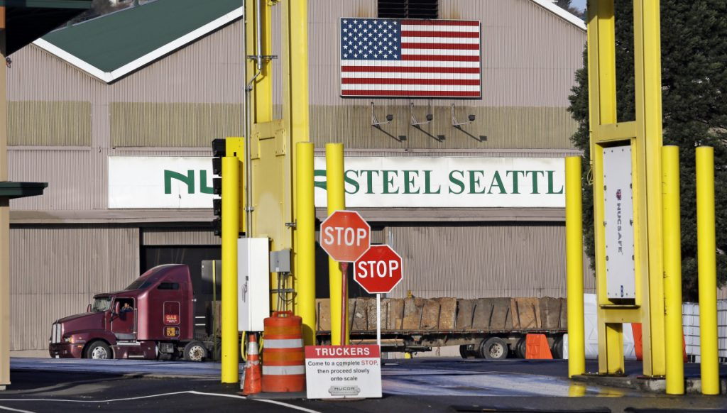 A truck carries a load at the Nucor Steel plant in Seattle. U.S. companies pursuing exemptions from President Trump's tariff on imported steel are accusing American steel manufacturers of spreading inaccurate and misleading information, and they fear it may torpedo their requests.