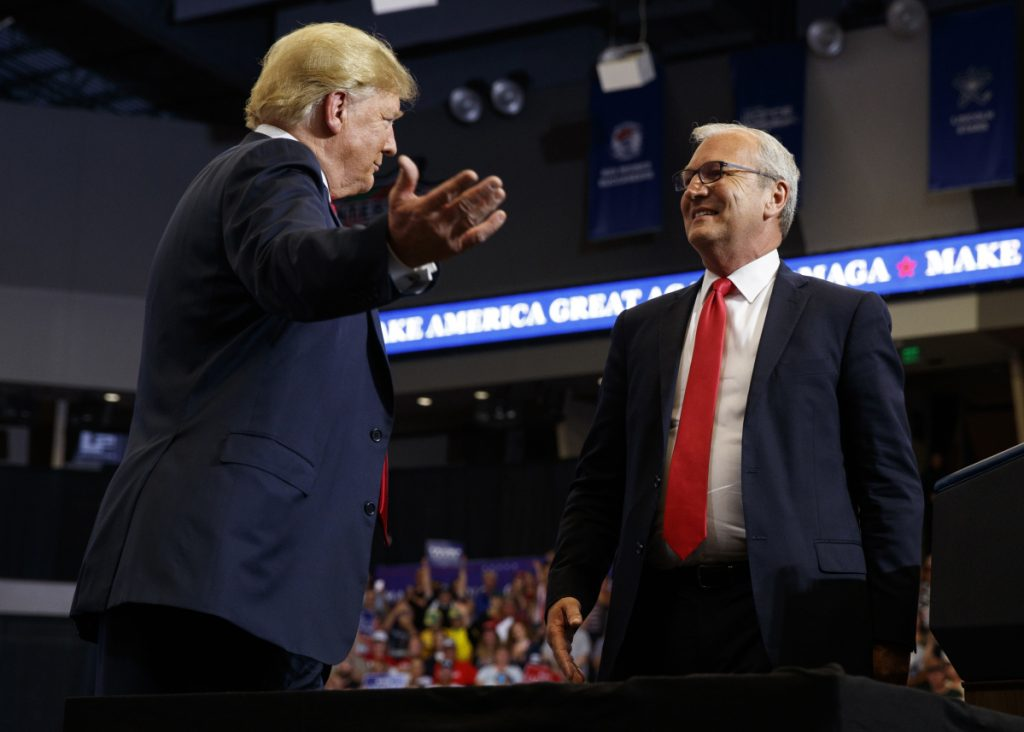 President Trump hugs Senate candidate Rep. Kevin Cramer, R-N.D., during a campaign rally in Fargo, N.D. on June 27. The conservative Koch brothers' network declared July 30, that it will not fund Cramer, the Republican Senate candidate in North Dakota, turning its back on the GOP in a marquee election — at least for now — after determining that the Republican challenger is no better than the Democratic incumbent Heidi Heitkamp.