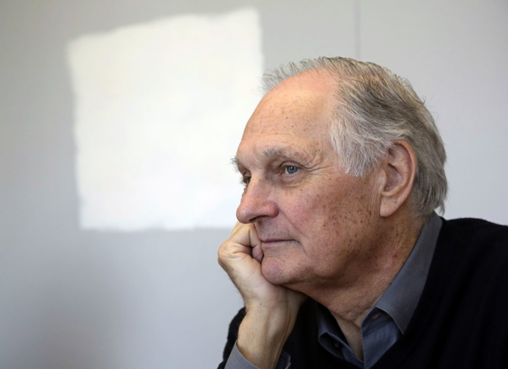 "Actor Alan Alda listens during an interview at Stony Brook University, on New York's Long Island in 2013.  Alda, appearing on ""CBS This Morning,"" said he was diagnosed with Parkinson's disease three and a half years ago."