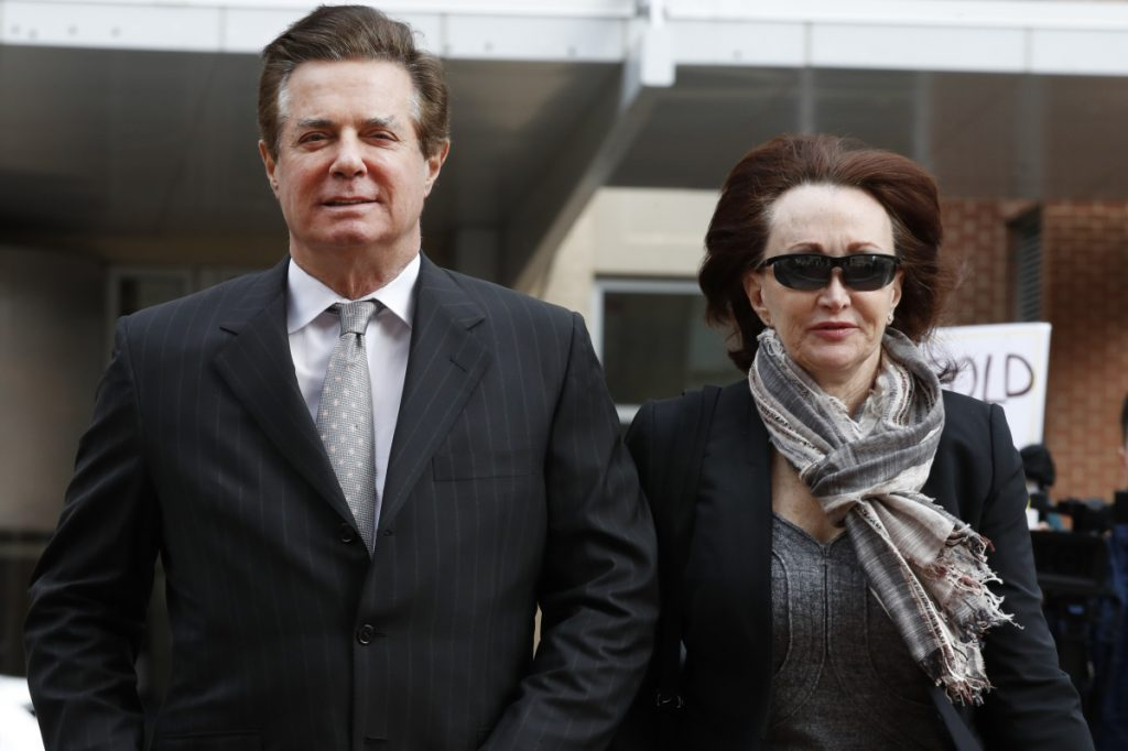 Paul Manafort, President Trump's former campaign chairman, arrives with this wife, Kathleen Manafort, at the federal courthouse in Alexandria, Va. in March. Manafort's trial on tax evasion and bank fraud charges began Tuesday.