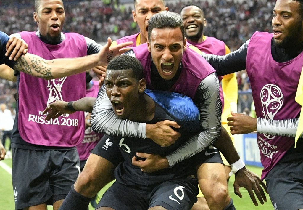 Paul Pogba, the Manchester United midfielder, carries a teammate in celebration Sunday after France won its first World Cup since 1998 and second overall by defeating Croatia 4-2 at Moscow. Pogba's left-footed shot in the second half gave France a 3-1 lead.
