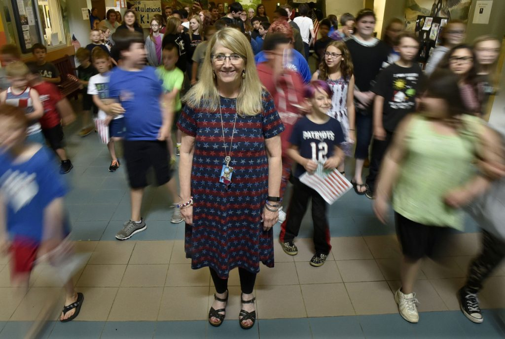 Vassalboro Community School Principal Dianna Gram stands in the hallway of the school as students file outside for a Flag Day celebration on June 14. Gram is retiring after some four decades as an educator and administrator.