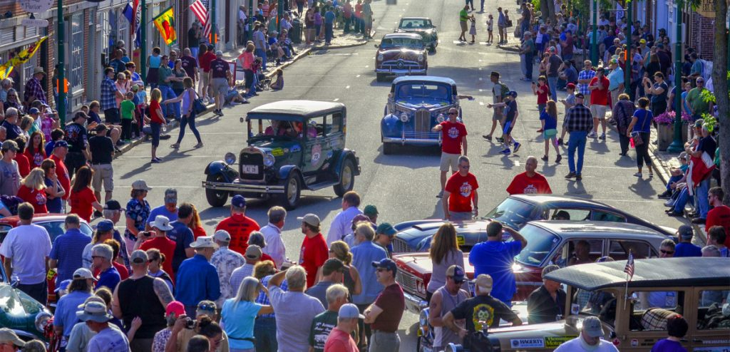 People watch on Tuesday as several Great Race cars come arrive June 26 on Water Street in Gardiner.