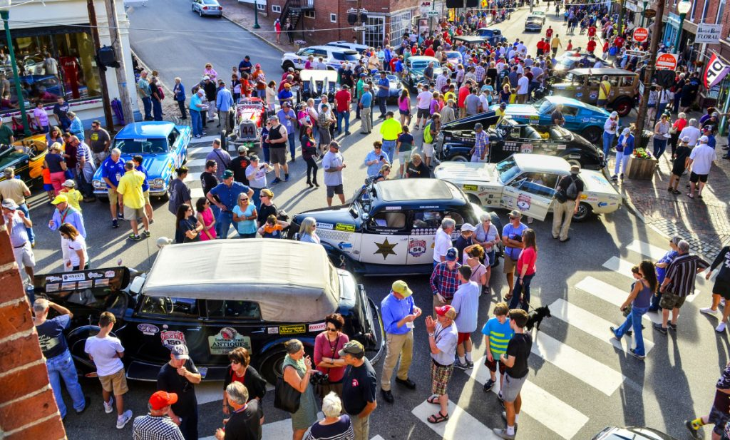 People check out Great Race vehicles on display June 26 at the intersection of Water and Church streets in Gardiner.