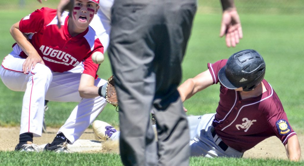 Augusta second basemen Aric Belanger, left, waits for the throw as Franklin County baserunner Bo Beaulieu is safe at second during an American Legion game Saturday in Augusta.