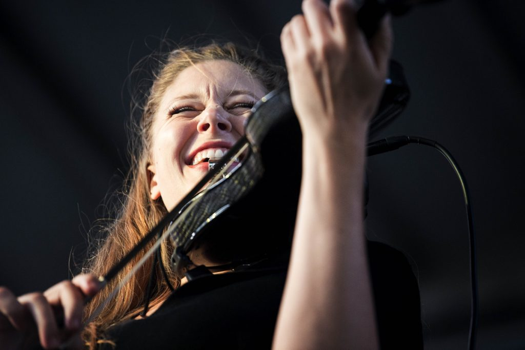 Corinna Smith, violinist for the Adam Ezra Group, performs with the group Friday at the kickoff concert of the Waterville Rocks! summer concert series at Castonguay Square in downtown Waterville.