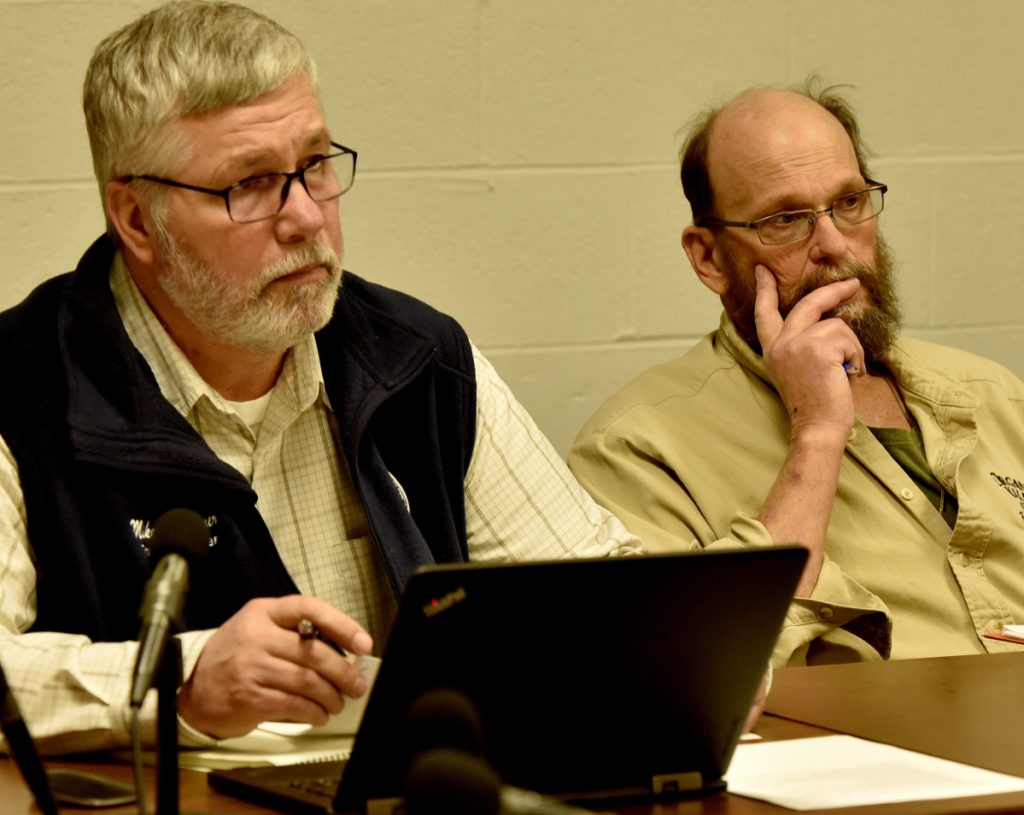 Winslow Town Manager Mike Heavener, left, and Council Chairman Steve Russell listen March 19 to an AOS 92 budget presentation.