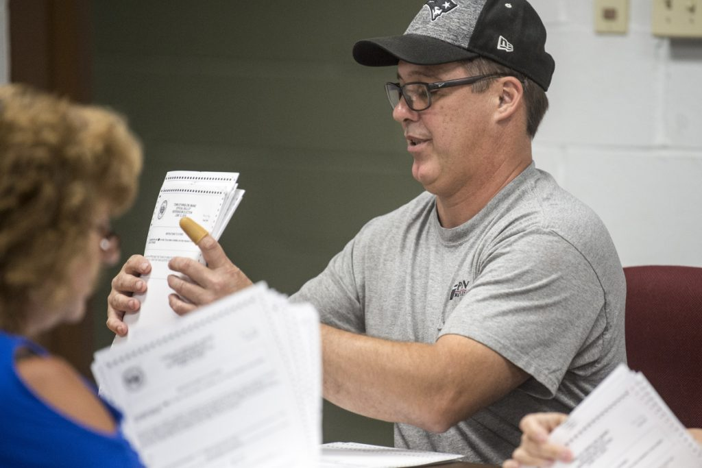 Todd Fredette, a representative of the 'yes' side of the school bond and budget issues who took part in a ballot recount Tuesday at the Town Office, and his 'no' partner, Kathy Aldridge, had to agree on the results of the recount for each 50-ballot batch before they could move on to the next batch.