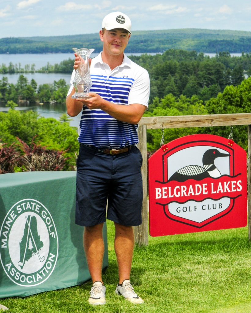 Jack Wyman holds the trophy after winning the Maine Amateur Championship on Thursday at the Belgrade Lakes Golf Club.