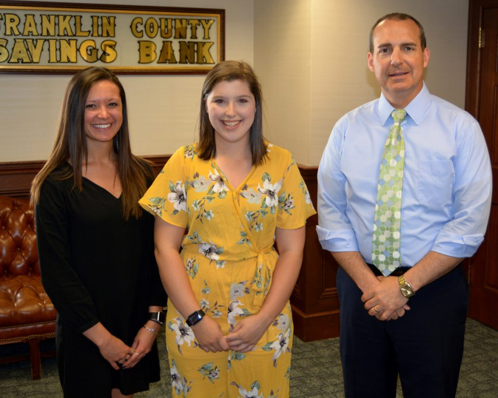 The Mt Abram High School scholarship was awarded to Emma Berube, center, with Franklin Savings Bank's Courtney Austin, left, and FSB President Tim Thompson.