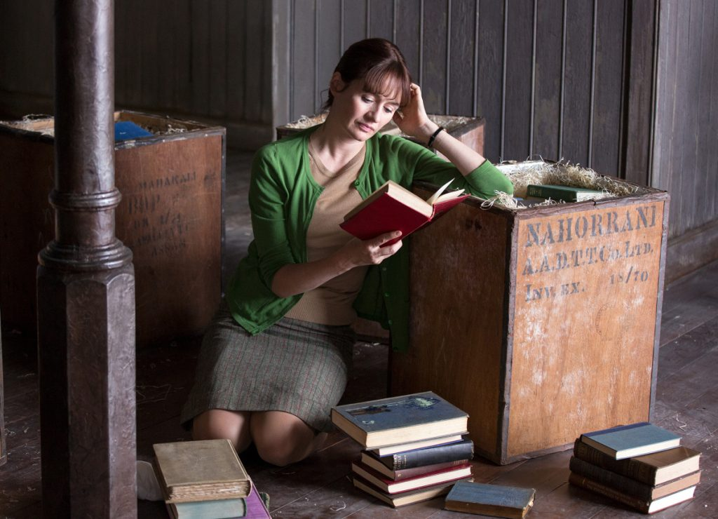 "Bookshop owner Florence Green (Emily Mortimer) gets lost in one of her products in the ""The Bookshop."""
