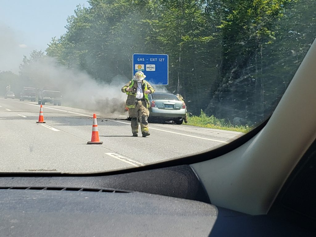 Waterville firefighters put out a fire that engulfed the engine of a car Friday in the northbound lanes of Interstate 95 near exit 27.