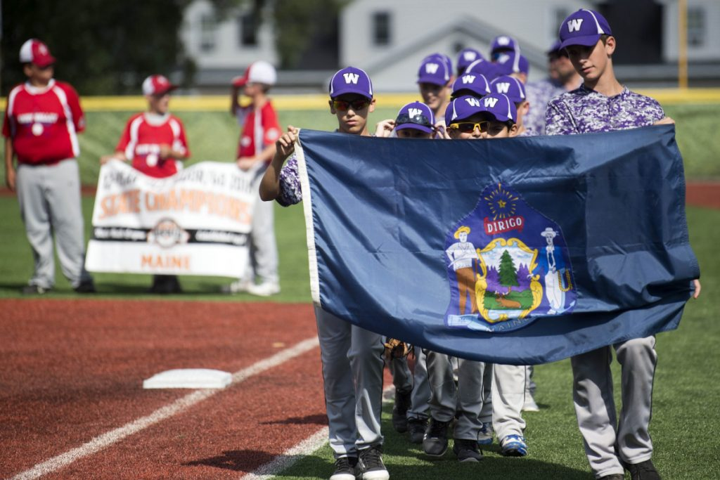 The Waterville baseball team marches onto the field for opening ceremonies for the Cal Ripken 12U New England regional tournament Friday at Purnell Wrigley Field in Waterville.