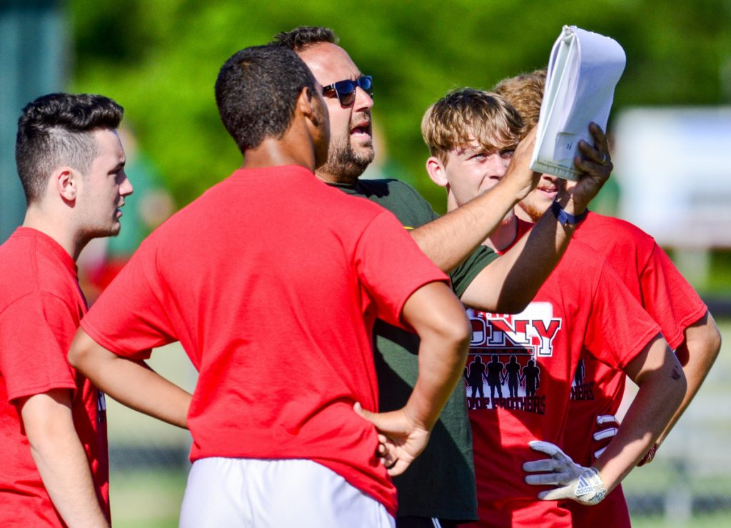 Cony coach B.L. Lippert gives his team a play in a game against Brunswick during a 7x7 tournament Friday in Turner.