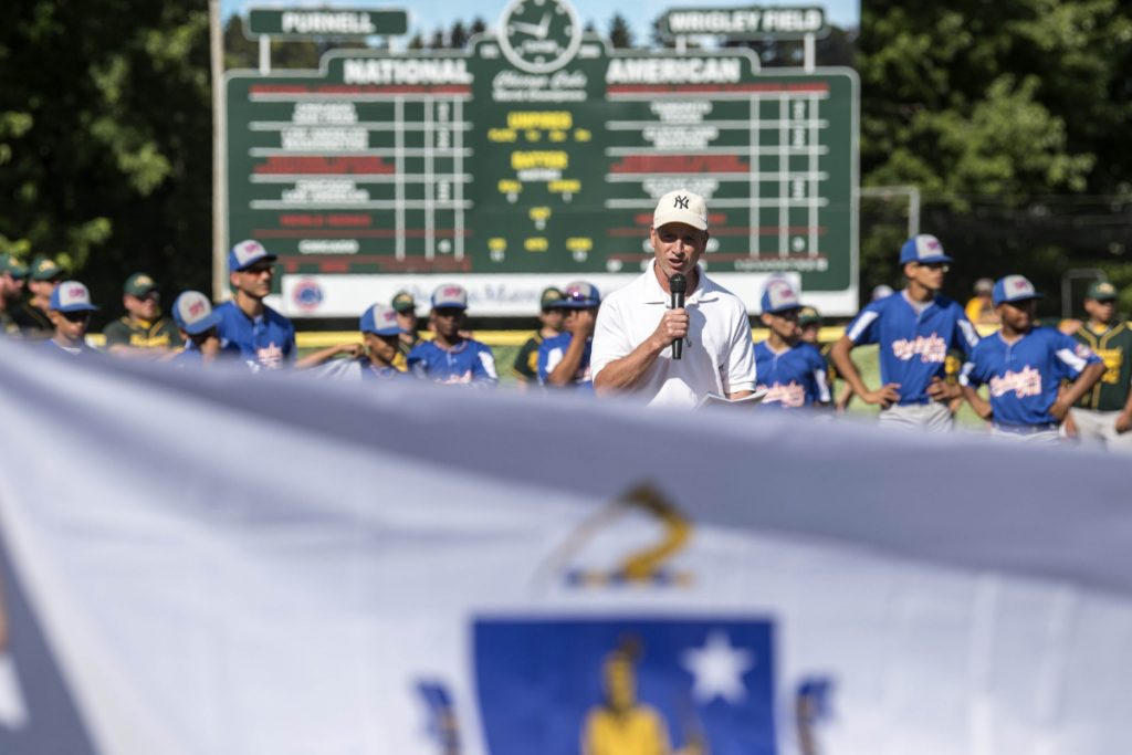Staff photo by Michael G. Seamans   Ken Walsh introduces Stump Merrill during opening ceremonies for the Cal Ripken 12U New England regional tournament Friday at Purnell Wrigley Field in Waterville.